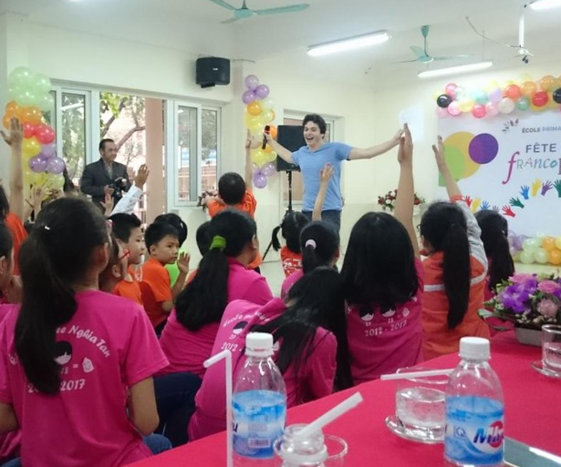 A student from Westpoint University gives a presentation to children in Vietnam during his group volunteer trip.
